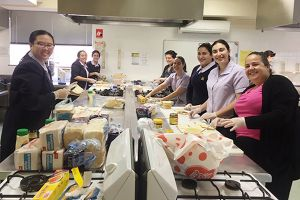Students preparing food for a feed the homeless mission