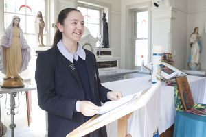 Student reading off the lectern