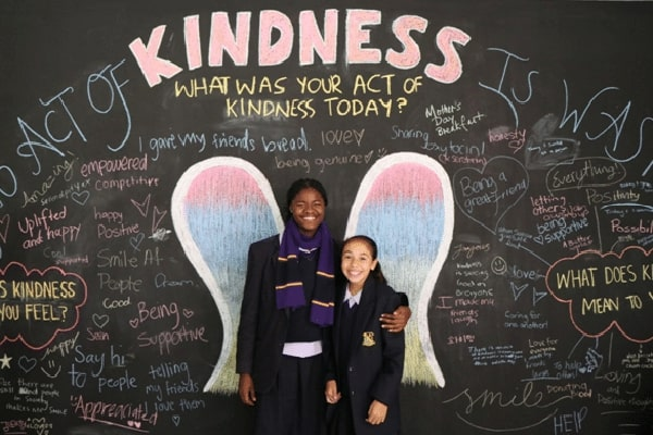 Students in front of the kindness wall