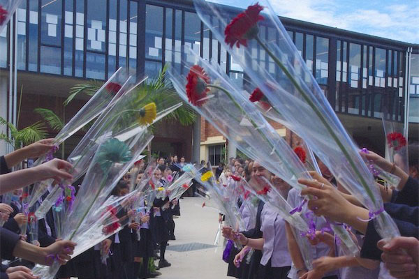 Bethlehem College Ashfield students lined up with flowers